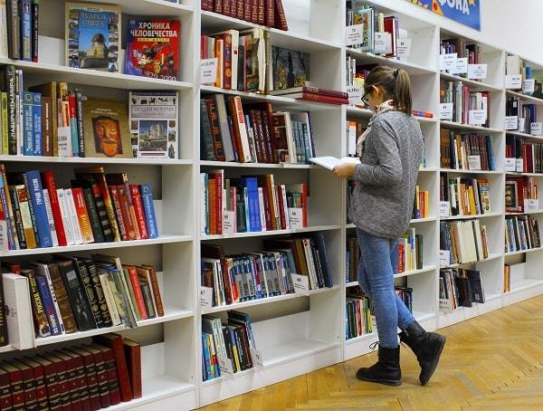 A girl reading books in the library